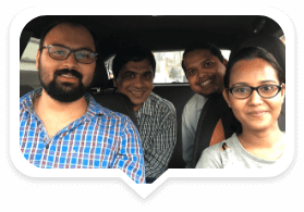 4 people sharing a ride in a car